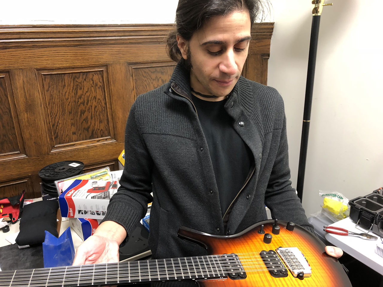 V.J. examining the Parker Fly 12-String Guitar in the lab