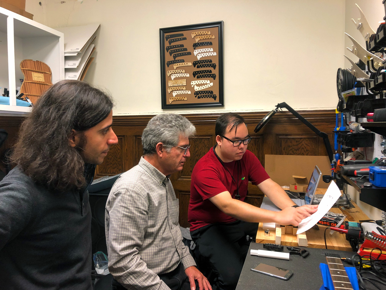 Instrument maker and EGIL project sponsor Ned Steinberger (center) working with a graduate student (right) to solve a vibrato system problem (2019)