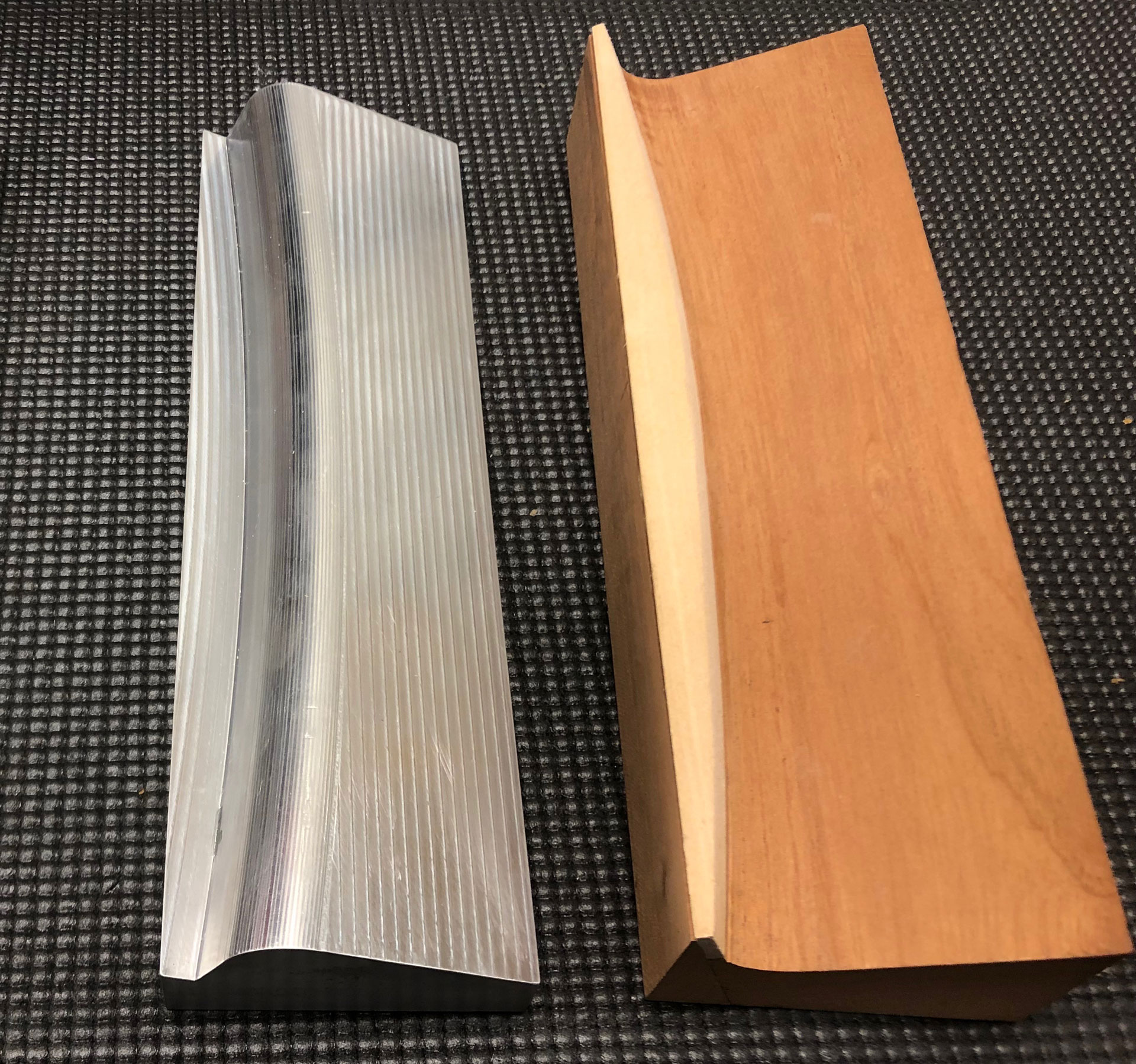 Hand-made wooden tool (right) analyzed, redesigned, and fabricated from aluminum (left)